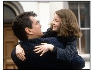 Evelyn movie still: Desmond Doyle (Pierce Brosnan) shares a happy moment with his daughter, Evelyn (Sophia Vavasseur) in Evelyn