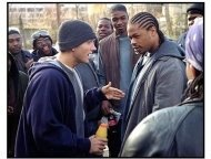 8 Mile movie still: Jimmy (Eminem) confronts a co-worker (Xzibit) a rap to defuse a volatile situation in 8 Mile