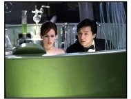 "The Tuxedo movie still: Jimmy Tong (Jackie Chan) and his rookie partner Del Blaine (Jennifer Love Hewitt) try to figure out how Banning intends to corner the market on the world's drinking water in ""T"