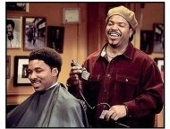 Barbershop movie still: Ice Cube as Calvin cutting up while cutting hair in Barbershop
