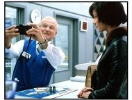 One Hour Photo movie still: Robin Williams as Seymour Parrish and Connie Nielsen as Nina Yorkin