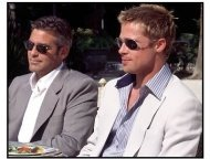 Oceans Eleven movie still: George Clooney as Danny Ocean and Brad Pitt as Rusty Ryan